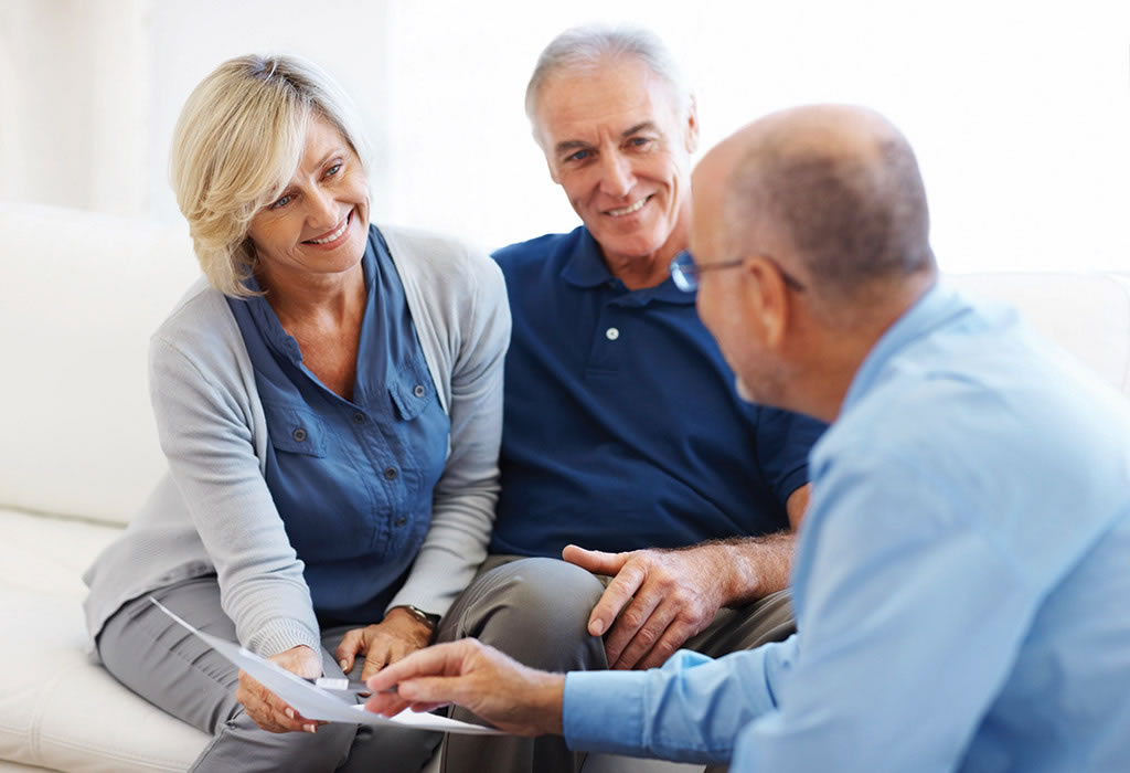 Couple discussing pensions with advisor